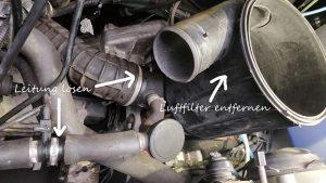 Weitere Leitungen lösen und dann den Luftfilter entfernen